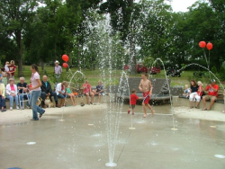 Children play in the fountain splash pad on July 4, 2009 after the re-dedication.