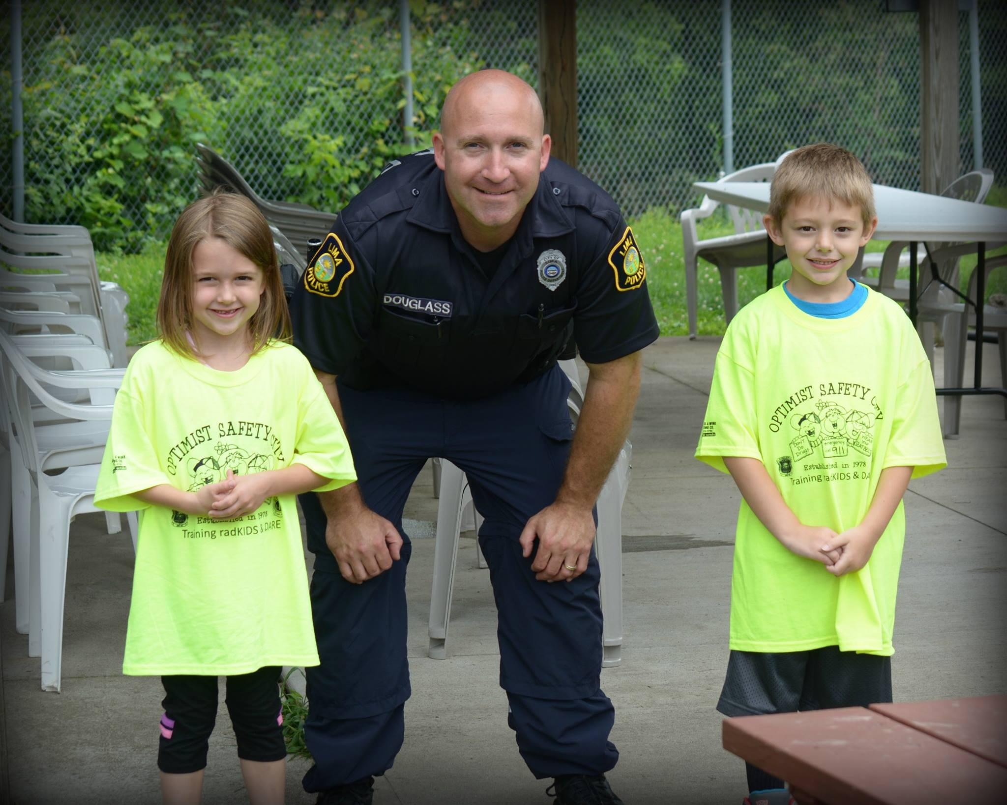 police officer with two children